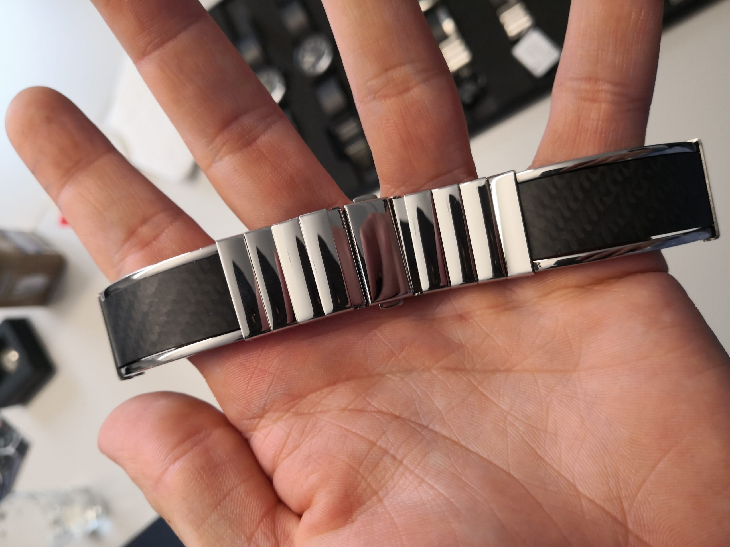 Polished stainless steel and carbon bracelet